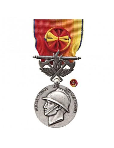 Médaille d'Honneur Sapeurs Pompiers Service Exceptionnel Argent en zamak argenté. Fixe ruban en option.
